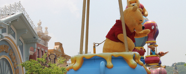 actor in Winnie the Pooh costume in a Hong Kong Disneyland parade