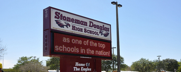 Marjory Stoneman Douglas High School sign, with the partial digital message 'as one of the top schools in the nation!'