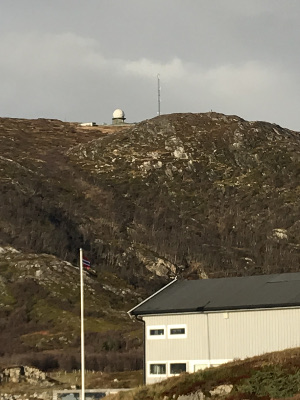 radar dome and radio mast at top of a hill