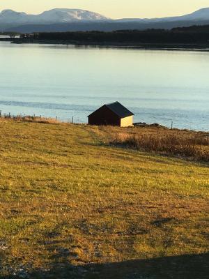 small farm shed with WWII-era blast damage near Tromso