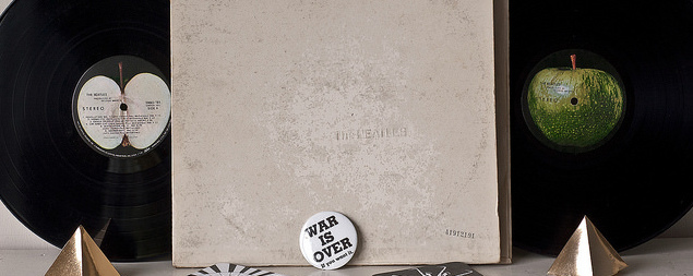 still life of 'The Beatles'/the 'White Album' double LP with a 'War Is Over' button
