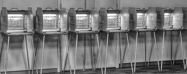 black and white image of voting booths used in the 2018 midterm elections