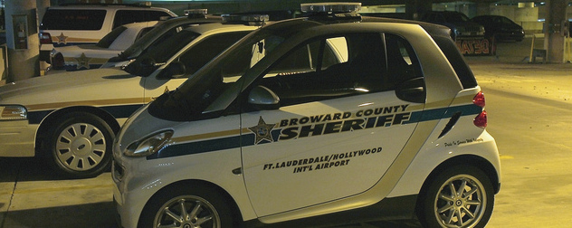 small car stamped with the Broward County Sheriff designation, with Ft. Lauderdale/Hollywood Int'l Airport beneath