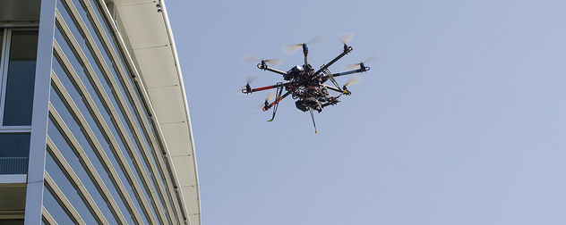 drone in flight near a building.