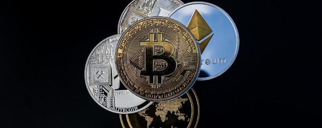 coins with various cryptocurrency symbols, including bitcoin, ethereum and others, on black background