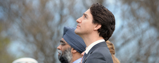 Justin Trudeau, looking up at the sky.