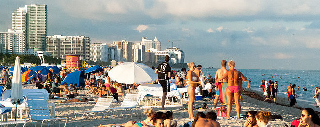 busy beach scene in Miami Beach, Florida.