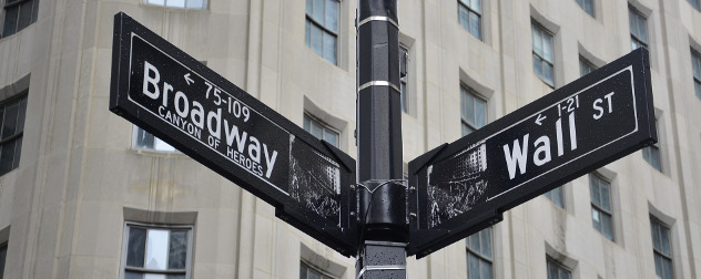 street signs for Broadway and Wall Street.