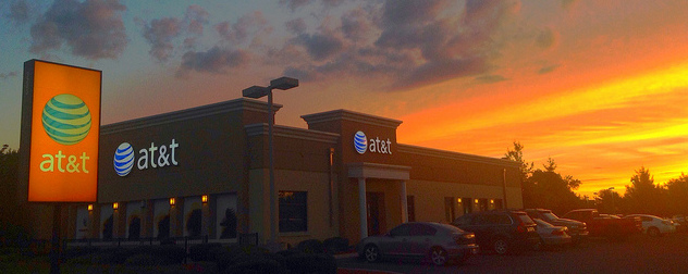 a stand-alone AT&T store at sunset.