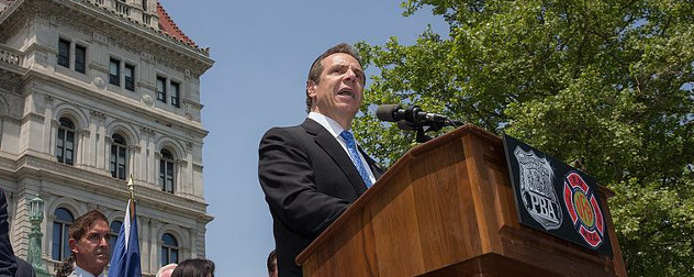 Andrew Cuomo speaking outside the New York State Capitol.