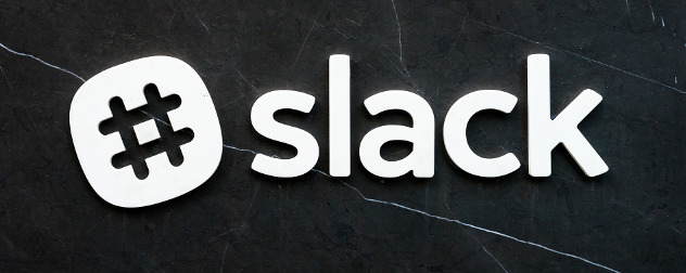 Slack logo against a black stone wall.