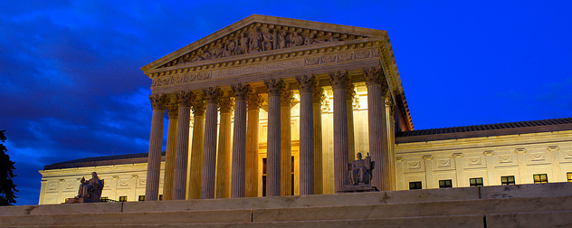U.S. Supreme Court facade at night.