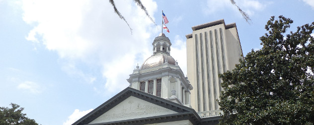 Florida's historic Capitol in the foreground, and the current Florida State Capitol in the background.