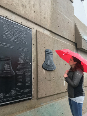 Aline Pitney, with umbrella, at the Halifax Explosion Memorial.