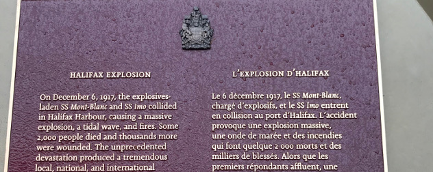detail of a commemorative plaque, in English and French, discussion the Halifax Explosion of 1917.