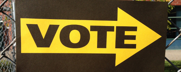 vote sign with yellow arrow.