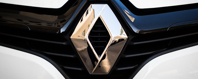Renault logo on a car grill, detail.