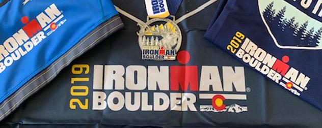 Ironman Boulder 2019 swag, including a shirt, medal, and bag.