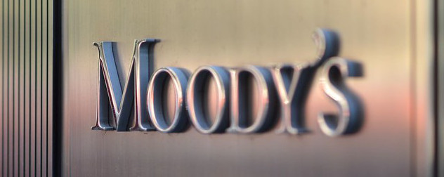 Moody's Investors Services logo on a wall.