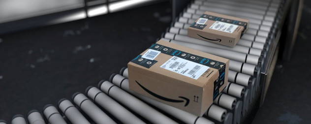 Amazon packages on a conveyor.