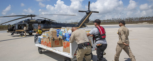 U.S. Customs and Border Protection loading disaster relief supplies onto a helicopter.