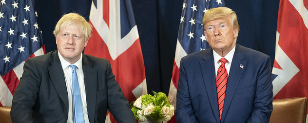 Boris Johnson and Donald Trump seated before U.K. and U.S. flags.