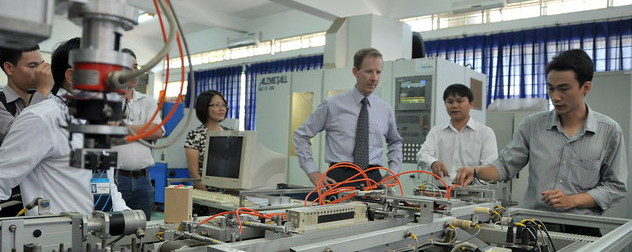 USAID Mission Director visiting Danang University of Technology in Vietnam.