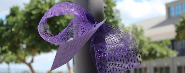 purple ribbon around a pole.