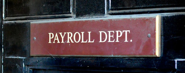 black door with red sign that reads 'Payroll Department'.