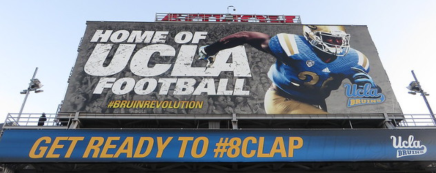 billboard advertising UCLA football, part of the NCAA's Pac-12 conference.