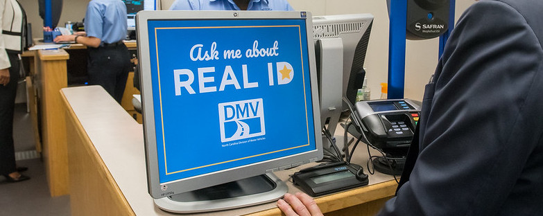 'Ask Me About Real ID' sign at a DMV.