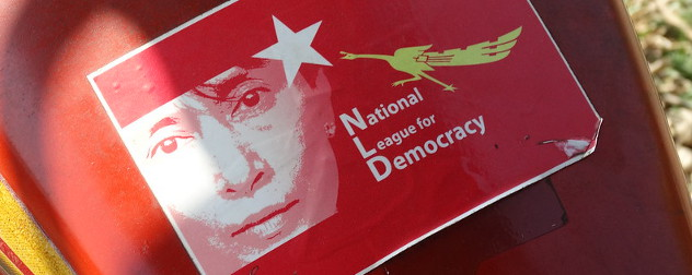 sticker promoting the National League for Democracy party, featuring Aung San Suu Kyi's face.