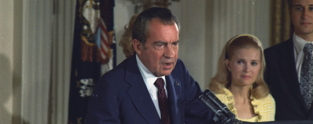 President Richard Nixon delivering his farewell address to his cabinet and White House staff.