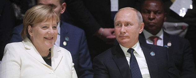Chancellor of Germany, Angela Merkel, and President of Russia, Vladimir Putin, at the 2018 Paris Peace Forum
