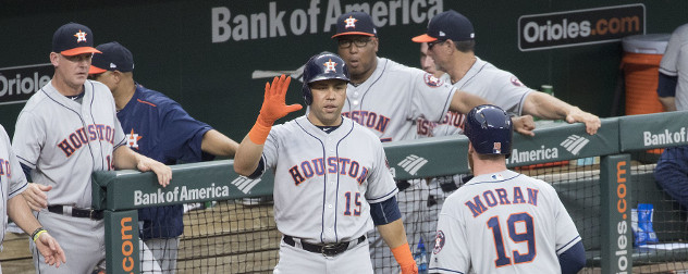 baseball player Carlos Beltran giving his Houston Astros teammate a high-five.