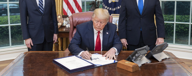 President Trump signing the Families First Coronavirus Response Act in the Oval Office.