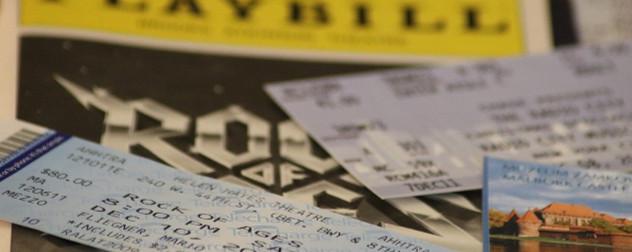 Broadway ticket, Playbill, museum tickets in soft focus.