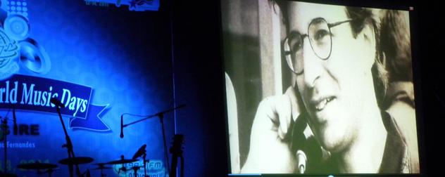 photograph of journalist Daniel Pearl displayed at a memorial concert.