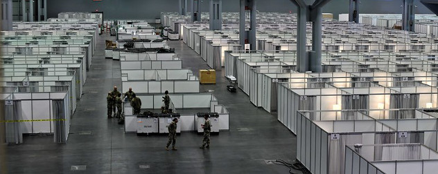 New York National Guard preparing the Jacob K. Javits Convention Center to become a 2,000 bed field hospital.