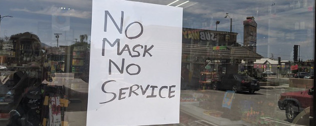 sign in store window that reads 'No Mask No Service'.