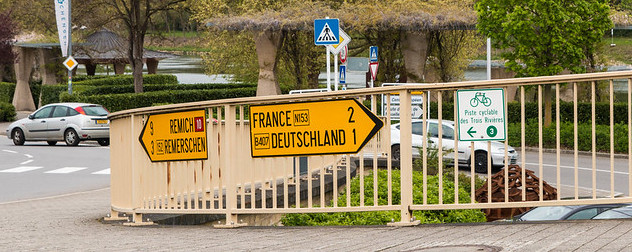 sign indicating the direction of the French and German borders in Schengen, Luxembourg.