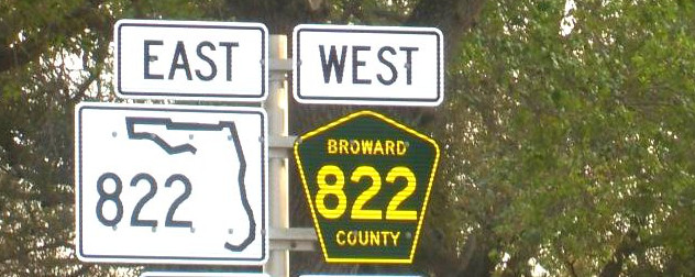 road sign indicating Florida State Road 822 to the East and Broward County Road 822 to the West.