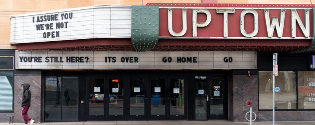 movie theater marquee with movie quotes indicating it is closed during the COVID-19 pandemic.