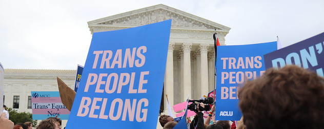 protesters outside the U.S. Supreme Court with signs, including one that reads 'Trans People Belong.'