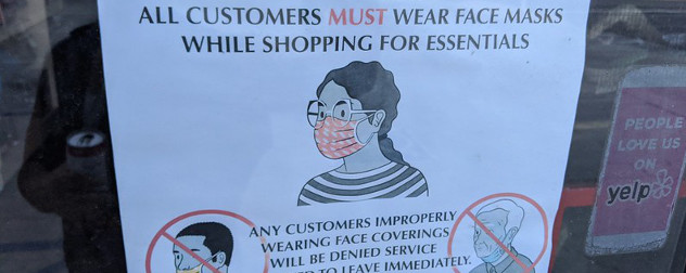 window sign specifying that customers must properly wear anti-COVID-19 masks while shopping to be served.