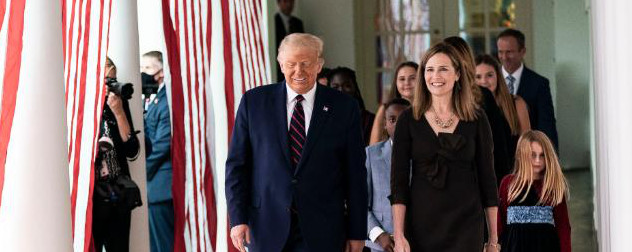 President Donald Trump walks with Amy Coney Barrett outside the White House.