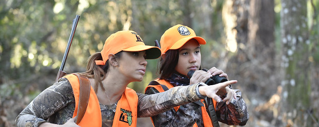 one hunter speaks to another while hunting deer in Florida.