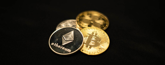 physical tokens representing various cryptocurrencies, including Ethereum and Bitcoin.