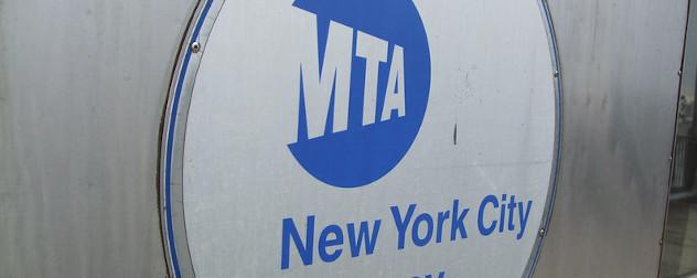 Metropolitan Transportation Authority (MTA) logo on the side of a New York City subway car.