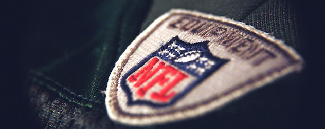detail of an NFL logo on a clothing item.